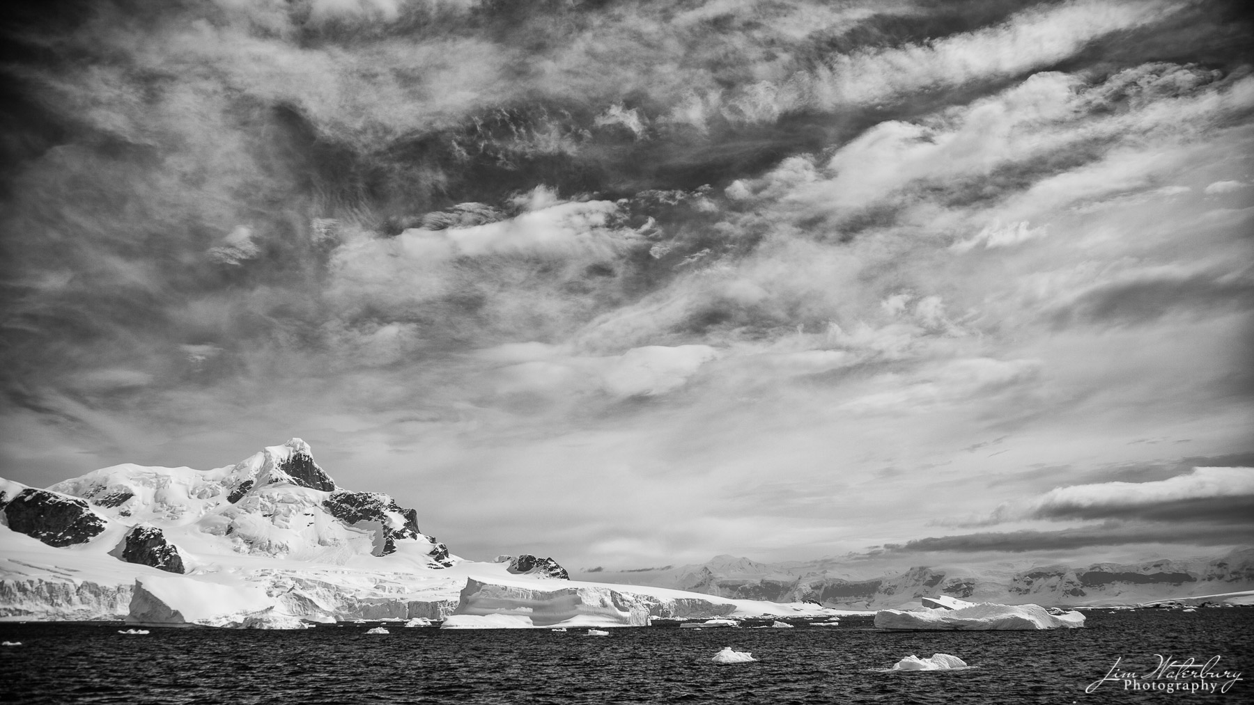 Antarctica, Cuverville Island, dramatic skies, snow, mountains , photo