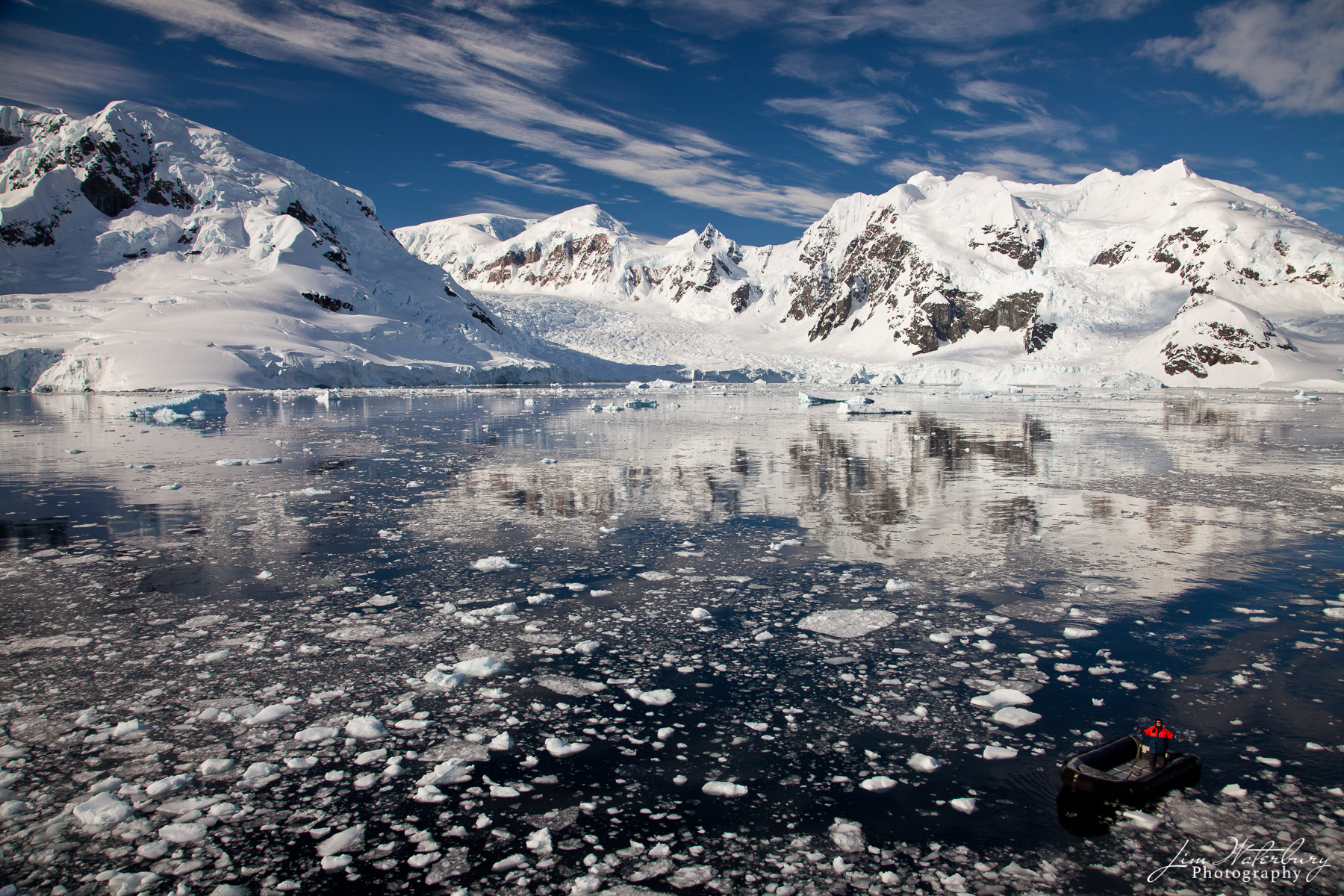 Antarctica, zodiac, boat, Paradise Harbour, mountains, broken ice, photo