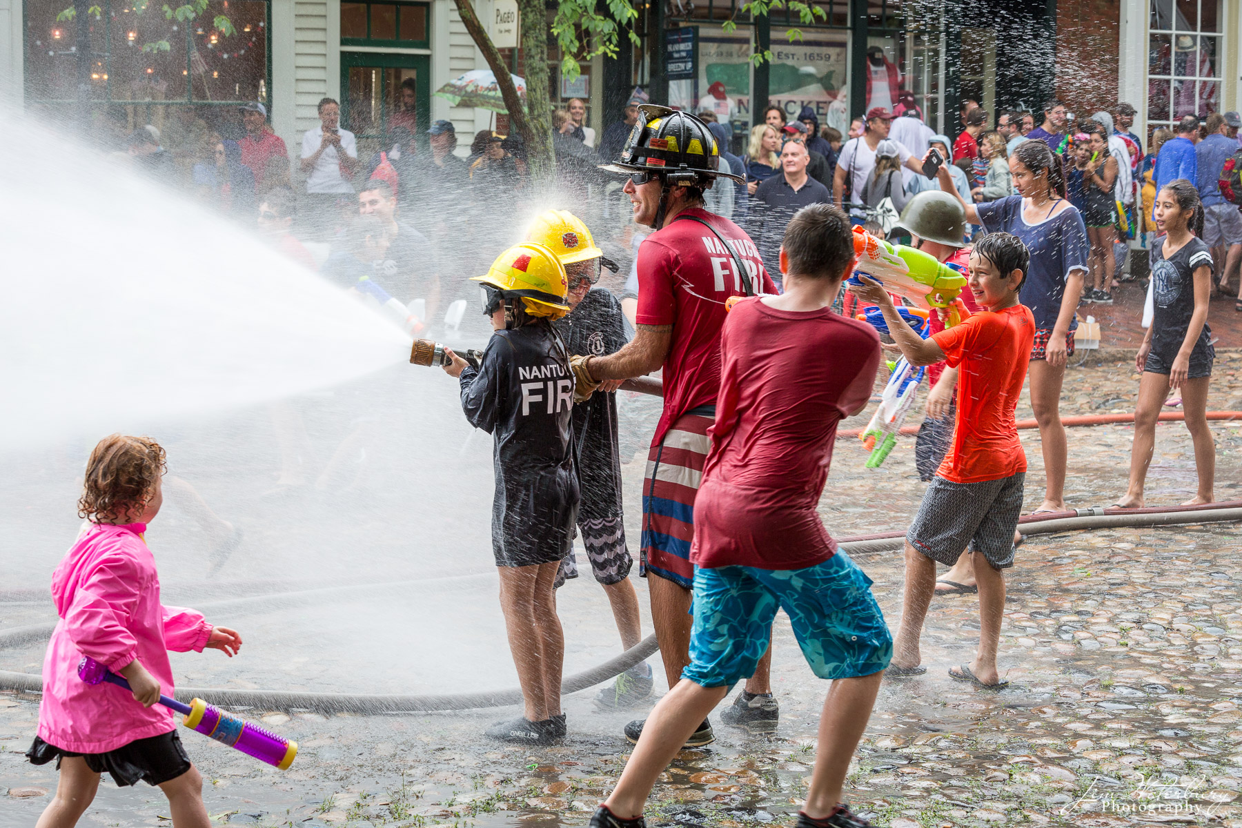 Each July 4th, the town of Nantucket hosts a friendly water fight between the Nantucket Fire Department, and volunteer fire fighters...