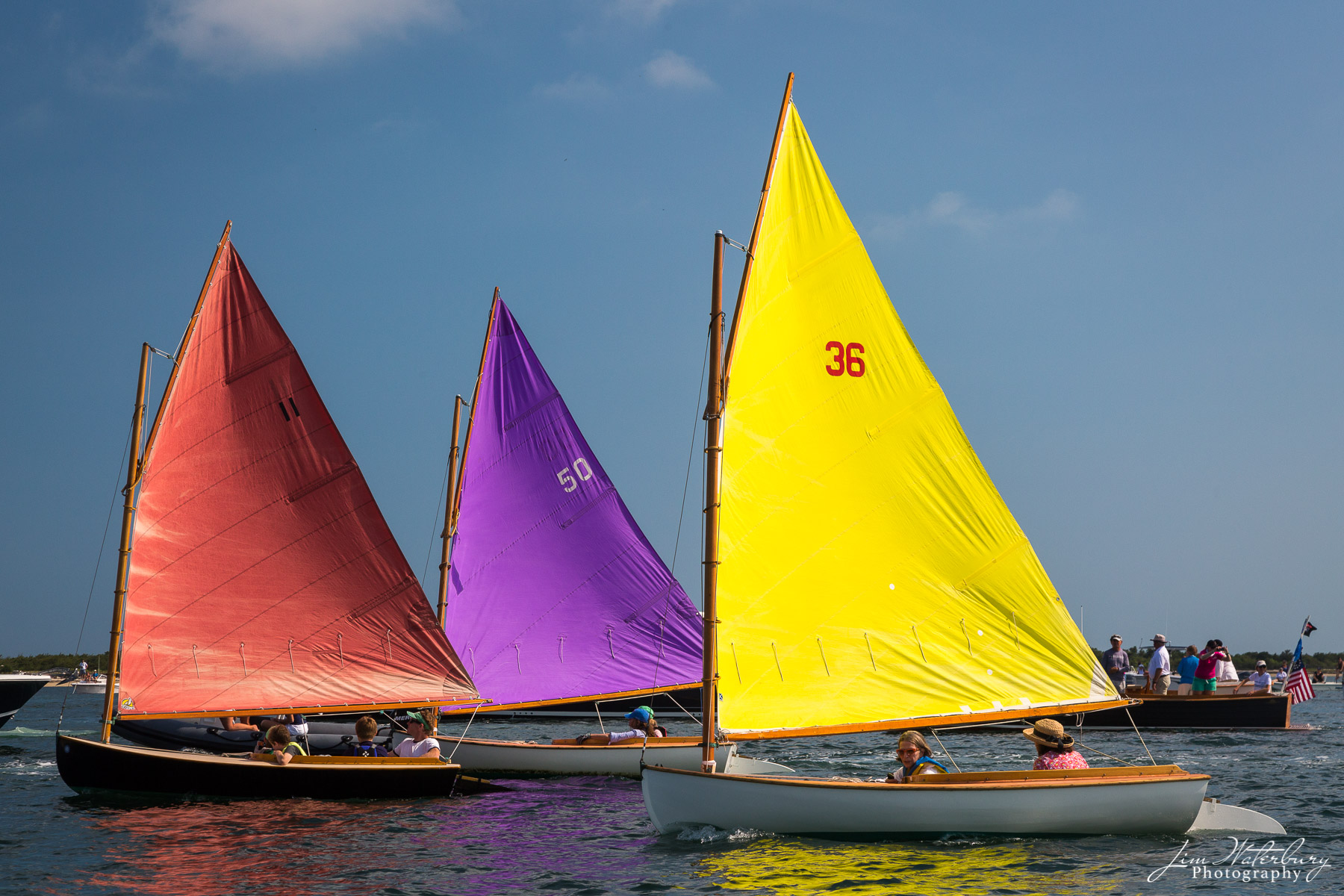Members of the Nantucket Rainbow fleet, with their colorful sails, kick off the final day of sailing at the annual Nantucket...