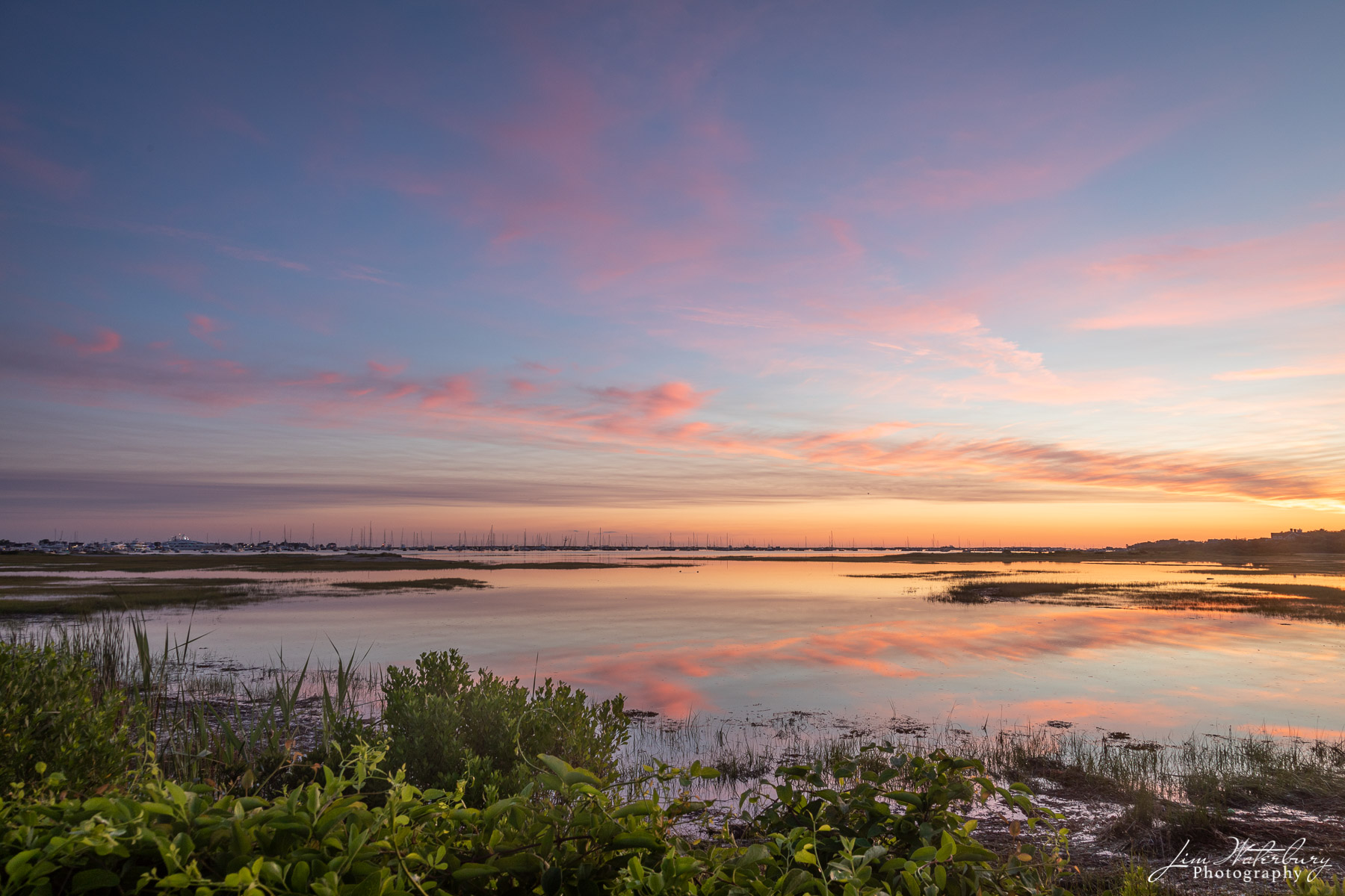 """Early morning clouds and reflections looking across the conservation land and """"The Creeks"""" from East Creek on Nantucket."""