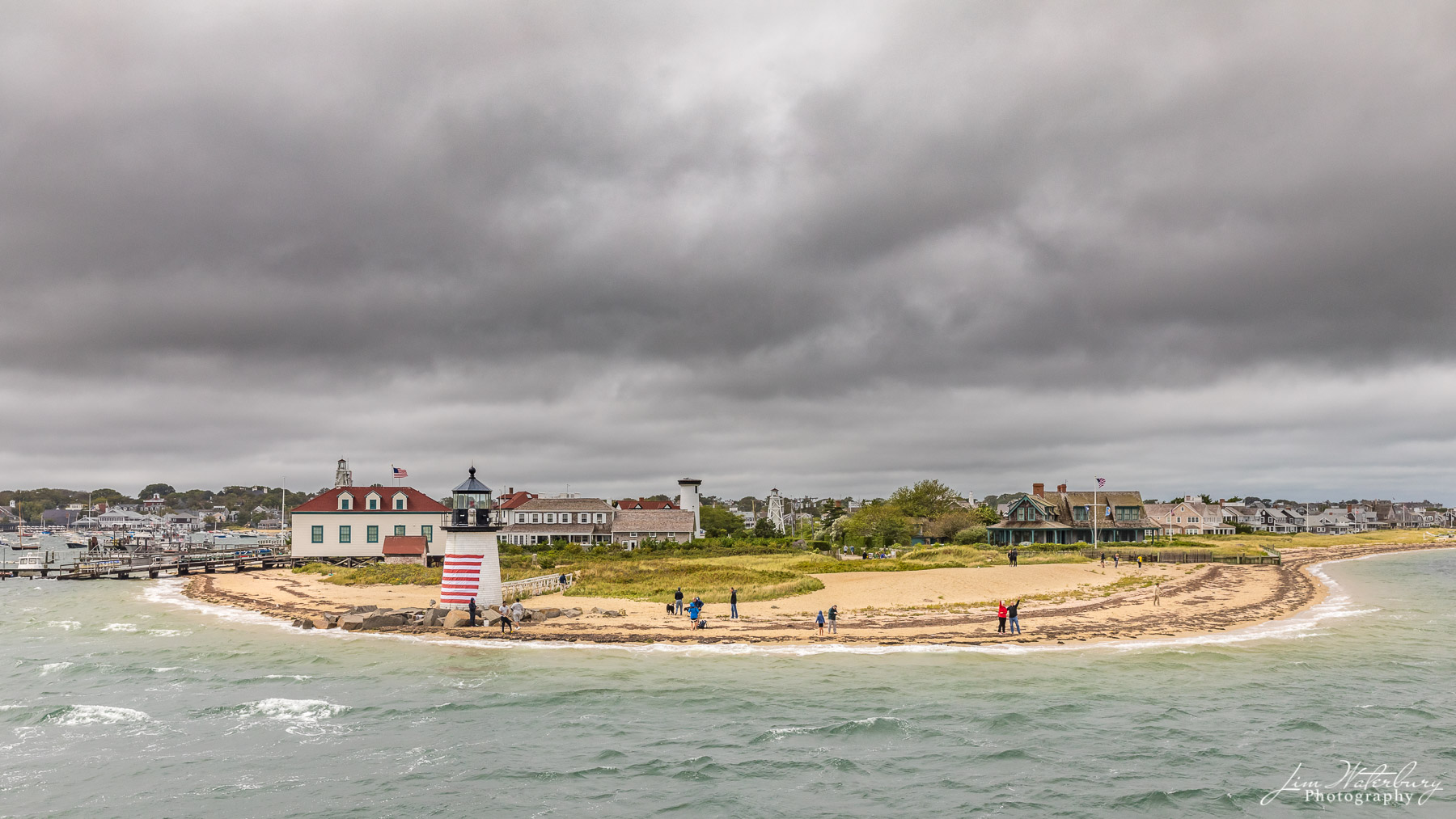 As the ferry rounds Brant Point Lighthouse, on a cold, windy and stormy September day, onlookers waive farewell ... until next...