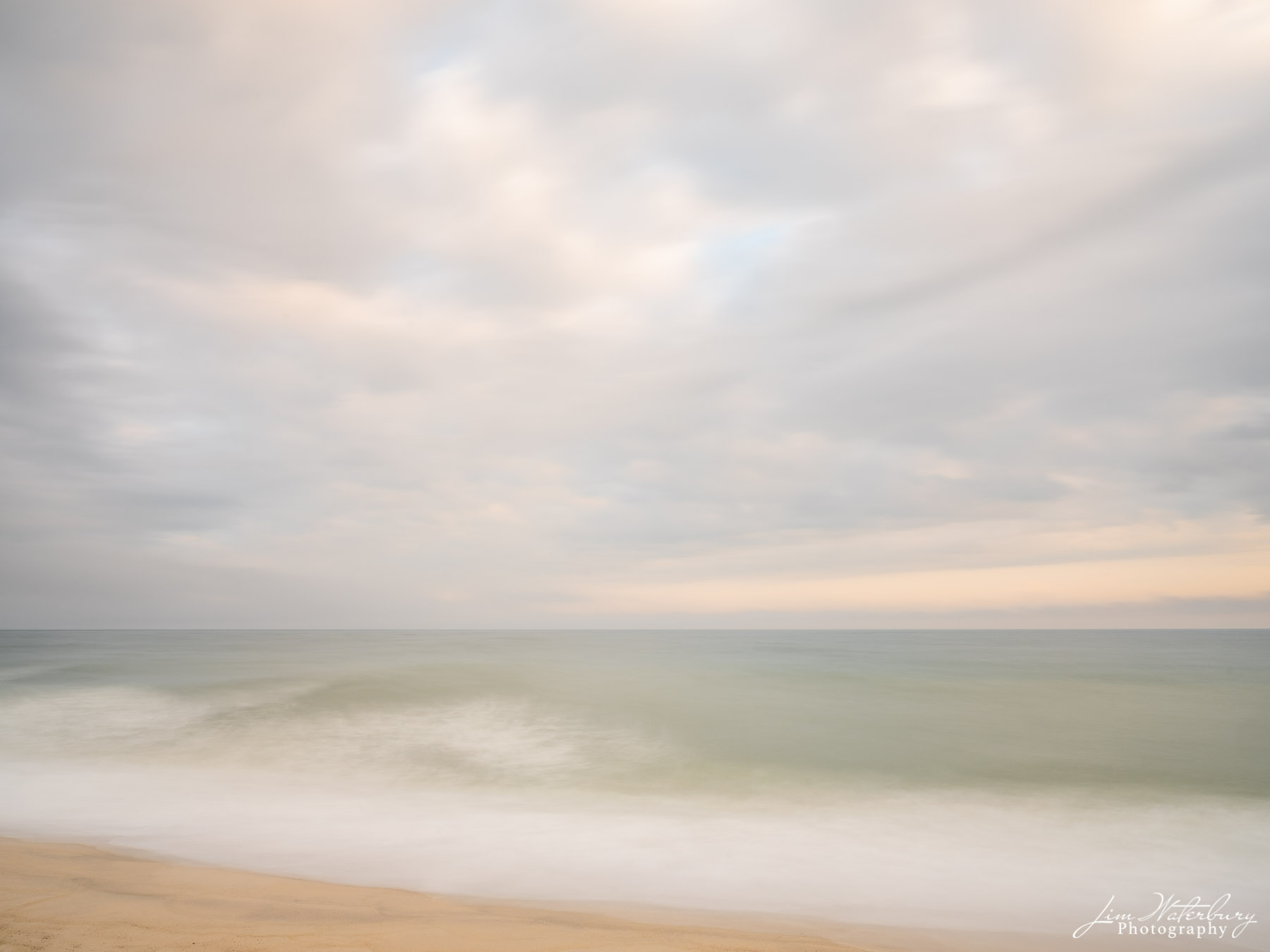 An impressionistic image of the ocean and subtle tones of an evening fall sky on Nantucket.