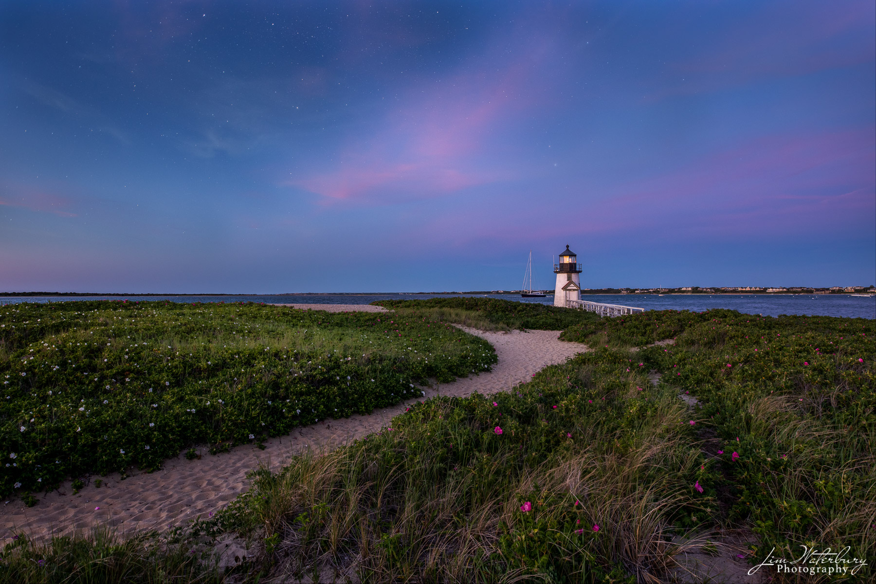 Image of the Brant Point Lighthouse, capturing the transition from evening to night, from the colorful pink skies that follow...