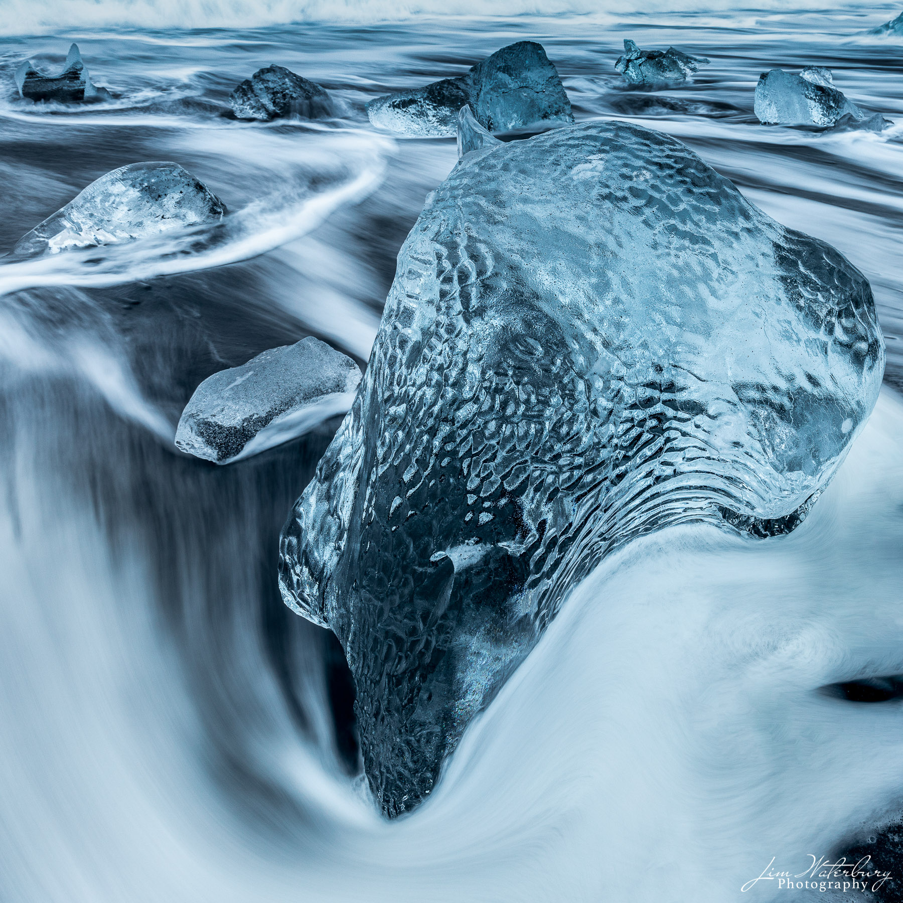 Close up image of ice, shaped by the foam from a receding wave, on Fellsfjara Beach (Diamond Beach), near the Jokulsarlon glacial...
