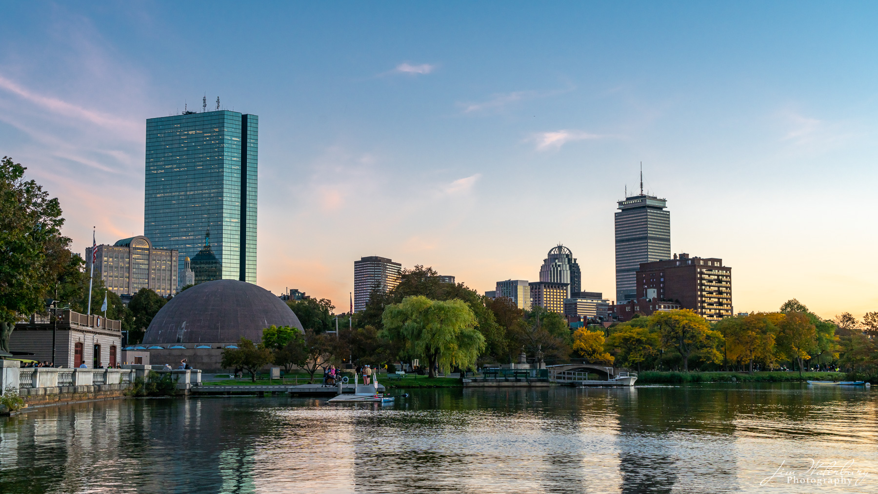 The Prudential Center and downtown Boston from the Charles River, in the evening light of a sunny October day.