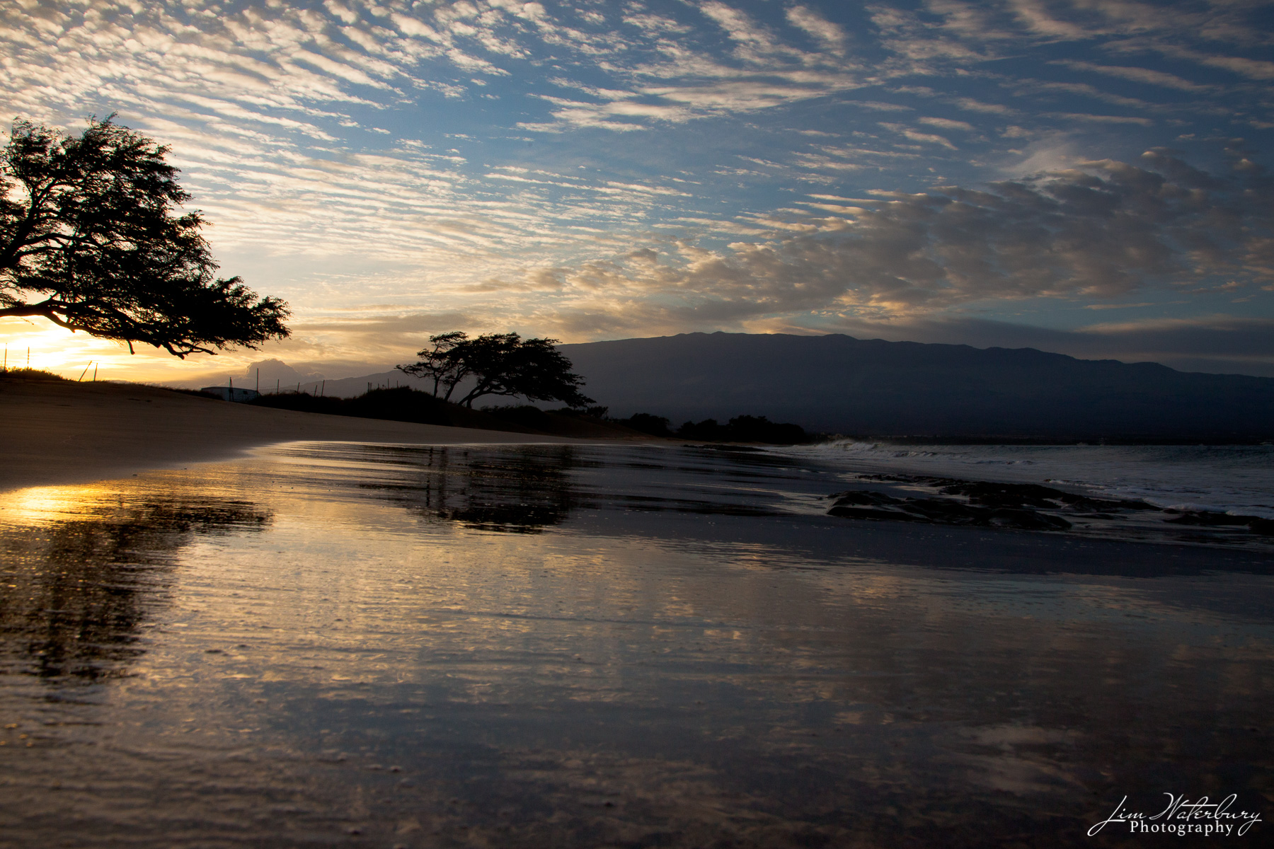 A new day dawns, just after sunrise along the bay by the Kealia Bird Sanctuary on the island of Maui.