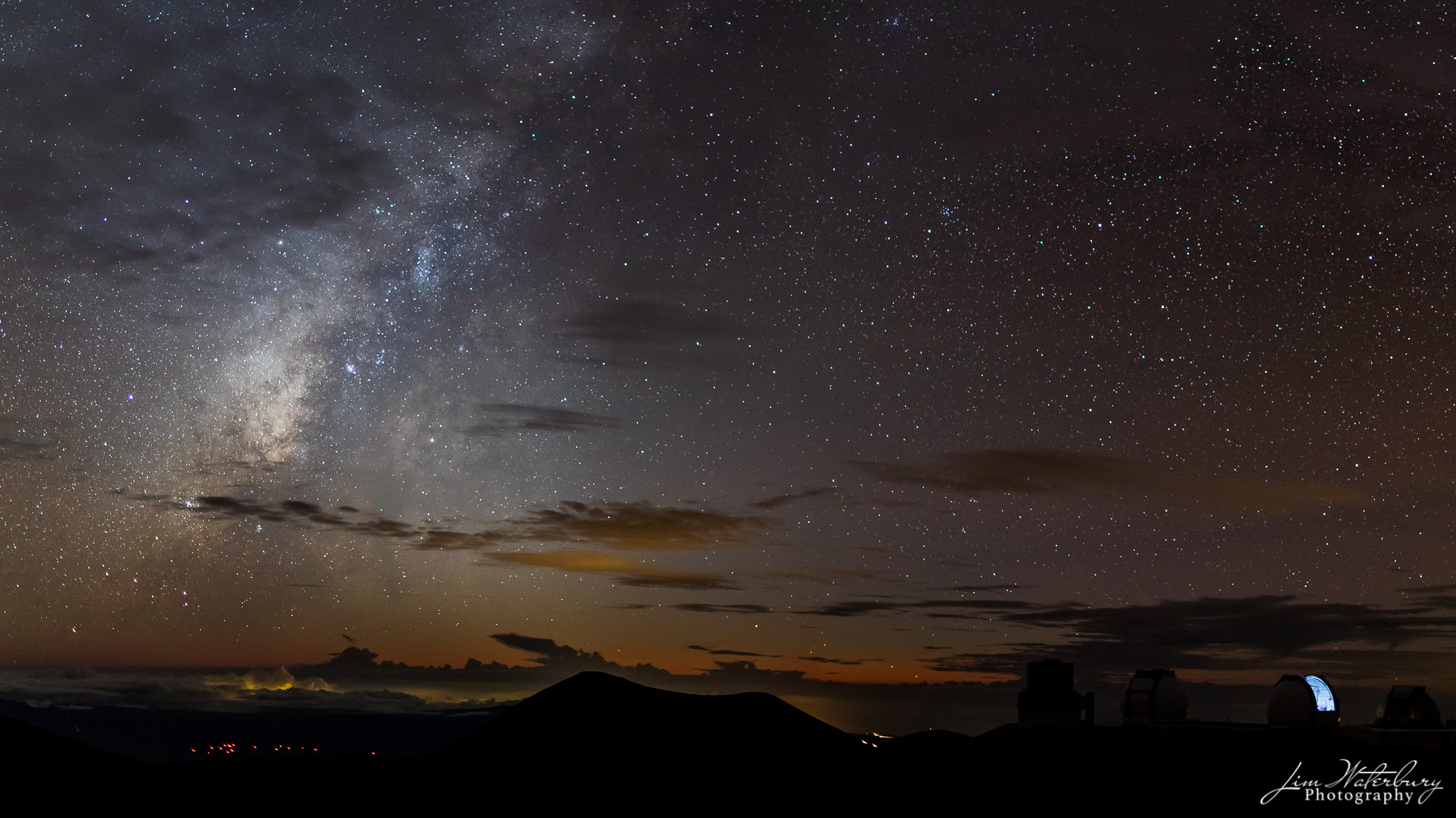 This panoramic image, taken shortly after sunset from the summit of Mauna Kea, Hawaii's tallest mountain, shows the Mauna Kea...