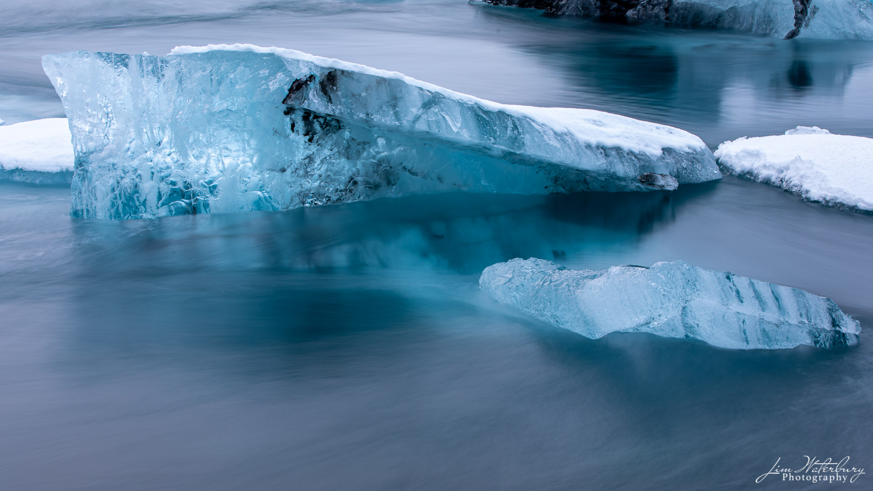 Ice sculpture reflected in the waters of the Jokulsarlon glacial lagoon, Iceland.