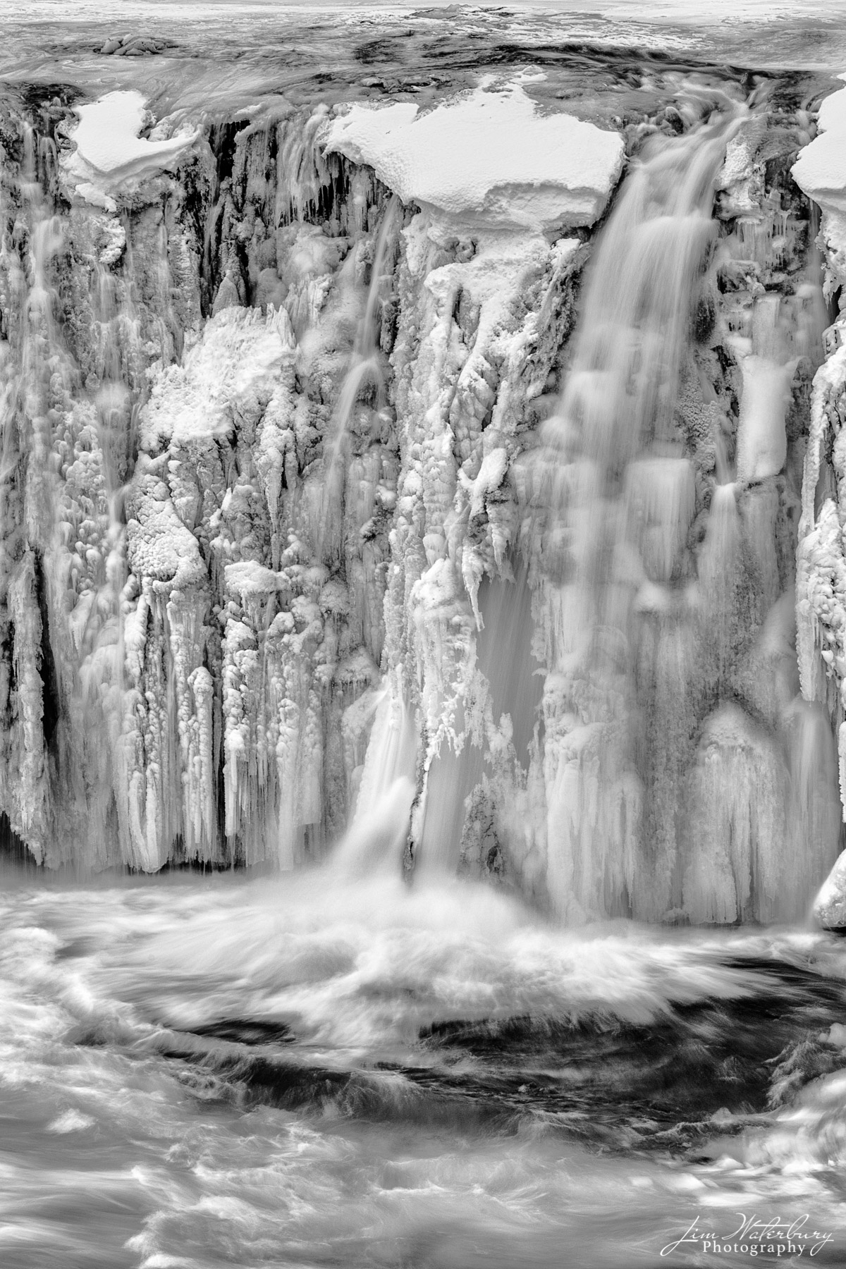 "Black & white image of detail of the Godafoss waterfall (""Waterfall of the Gods"") in Northern Iceland in winter."