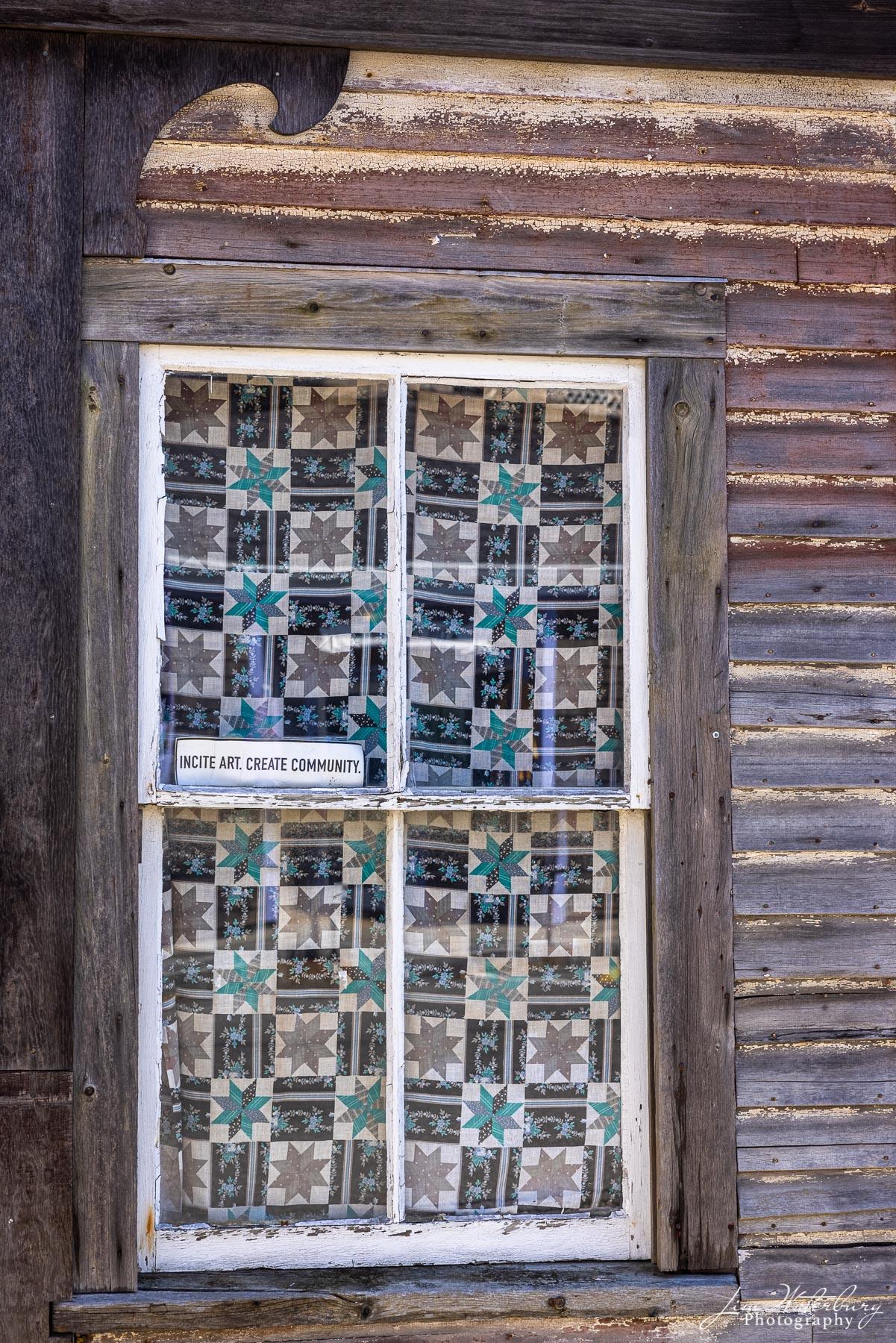 Window display in a Maine seaside village.