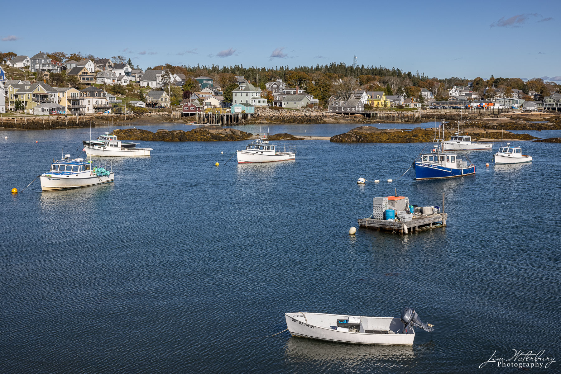 Boats and houses in the small harbor of Stonington, Maine.