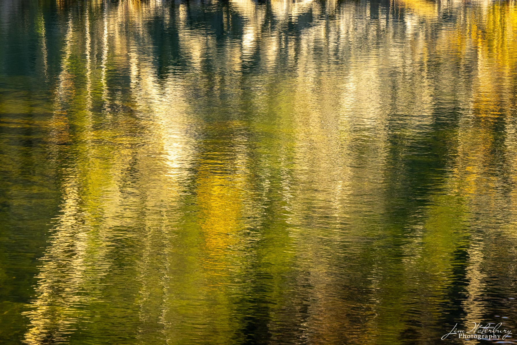 Fall reflections in the waters of Long Cove Quarry, Maine