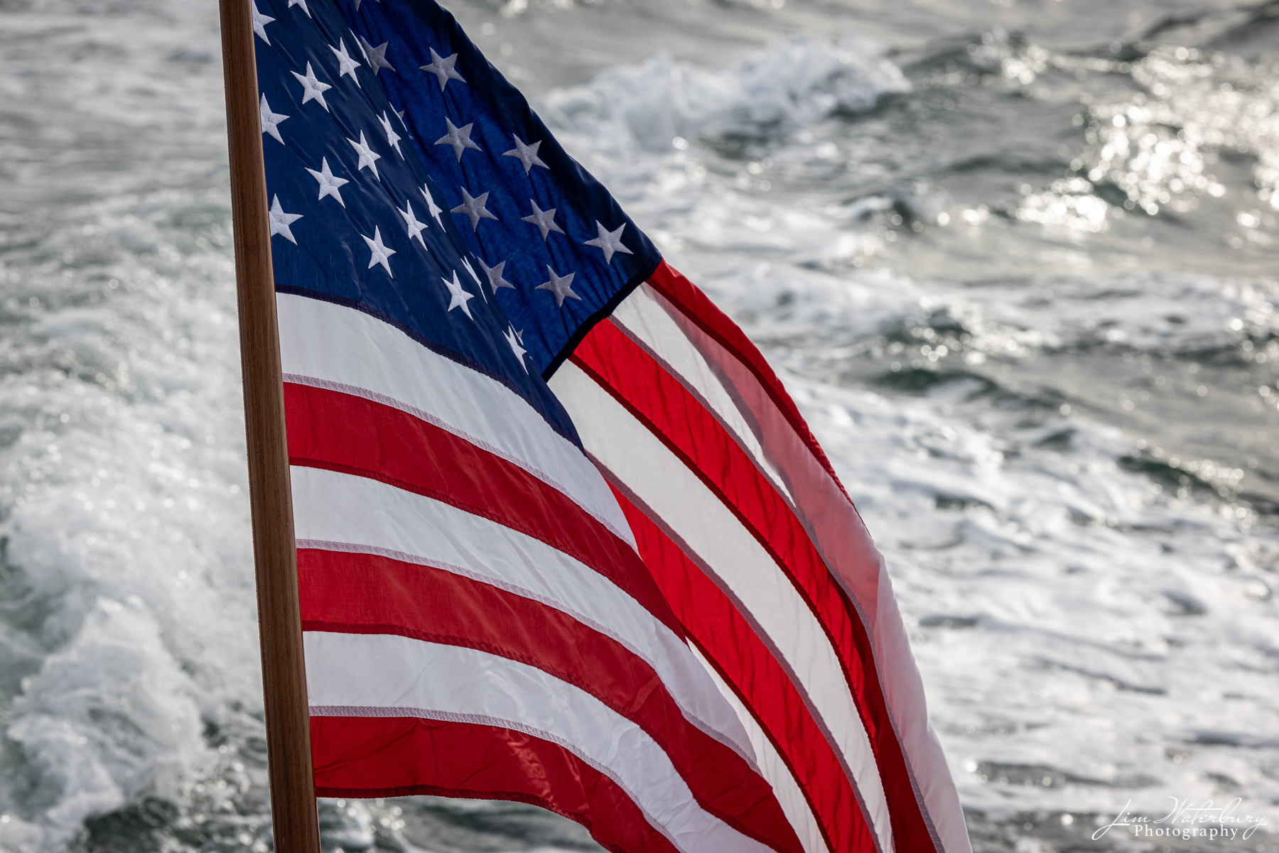 The American Flag flying from the stern of Midnight Rider.
