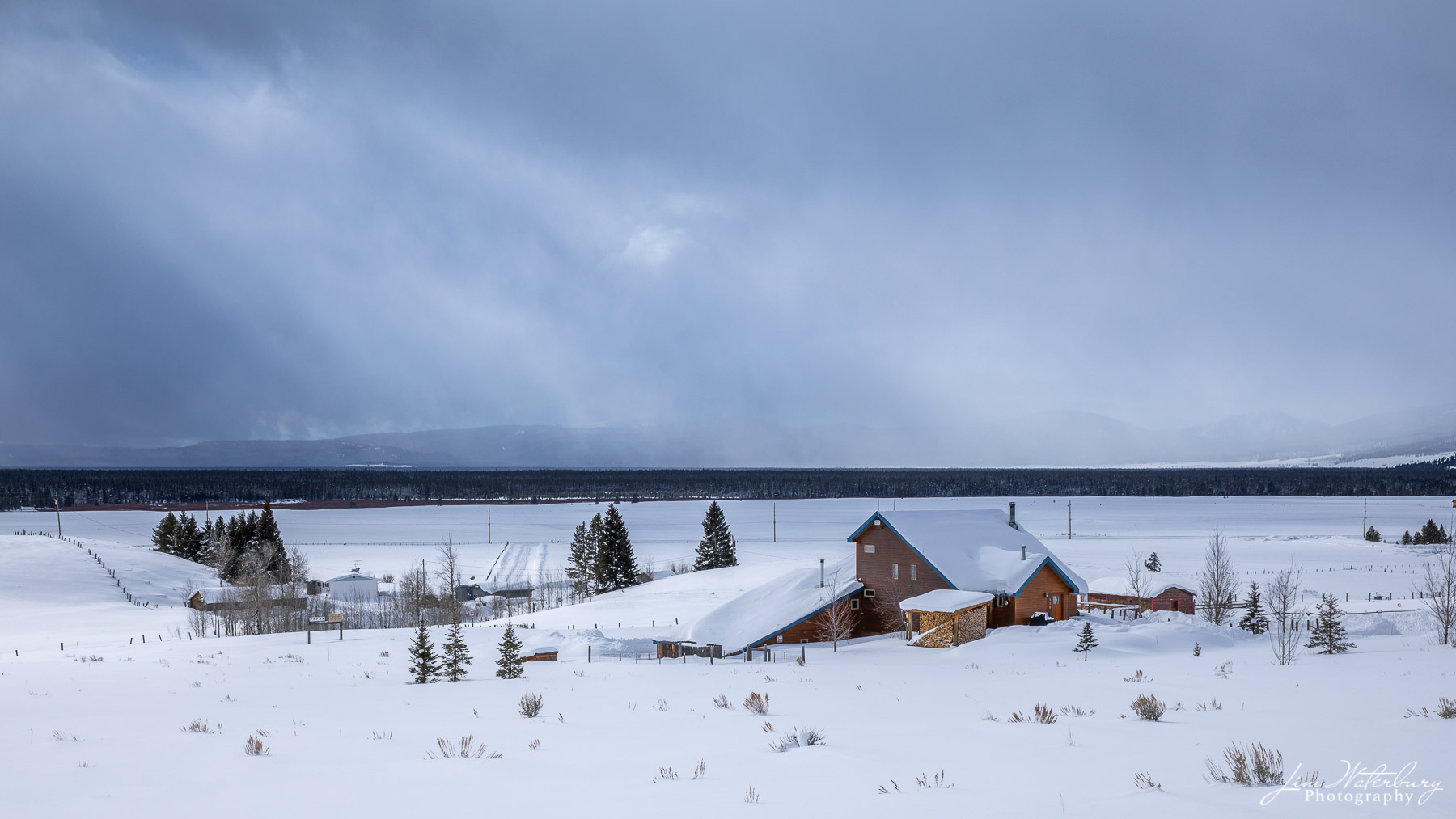 Farm outside West Yellowstone as a winter snowstorm begins to clear.
