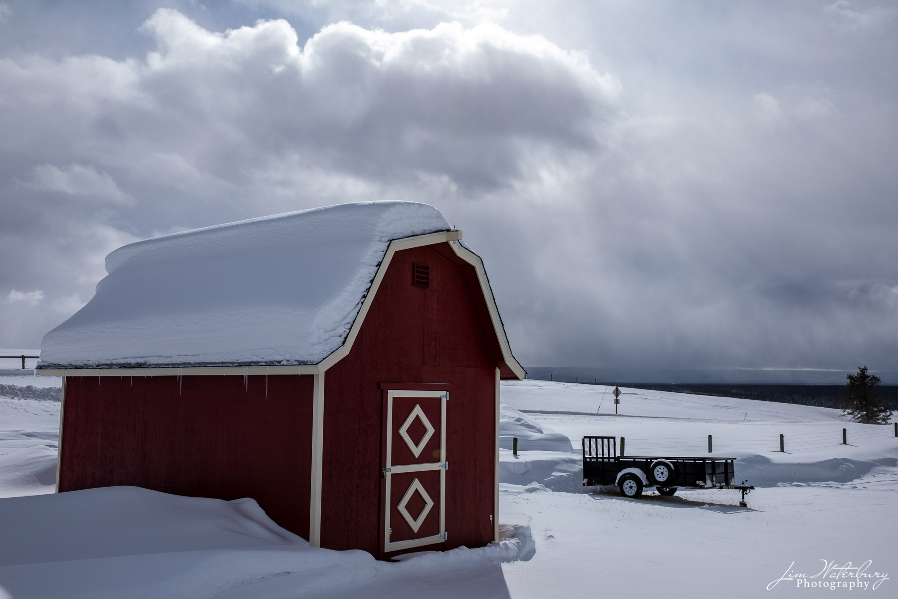 Farm outside West Yellowstone, as the sun starts to break through and the snow departs.