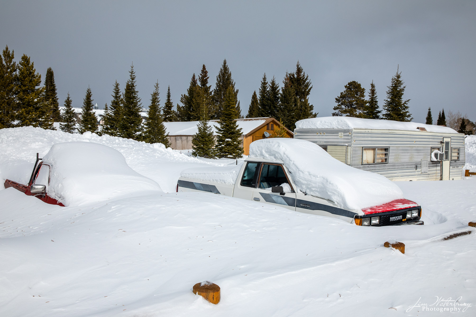 Mobile homes and trucks buried in snow -- consistent with the relative isolation of West Yellowstone in February.