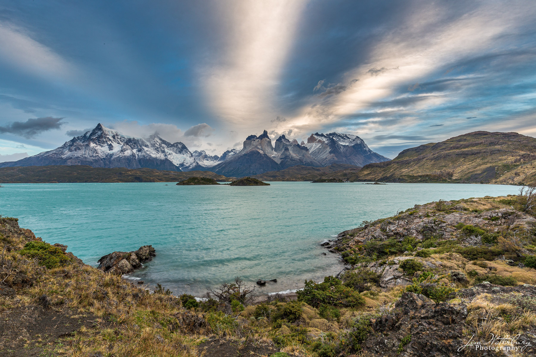 The turquoise waters of Pehoe Lake, in front of the Paine Massif, in Torres del Paine National Park, Patagonia.