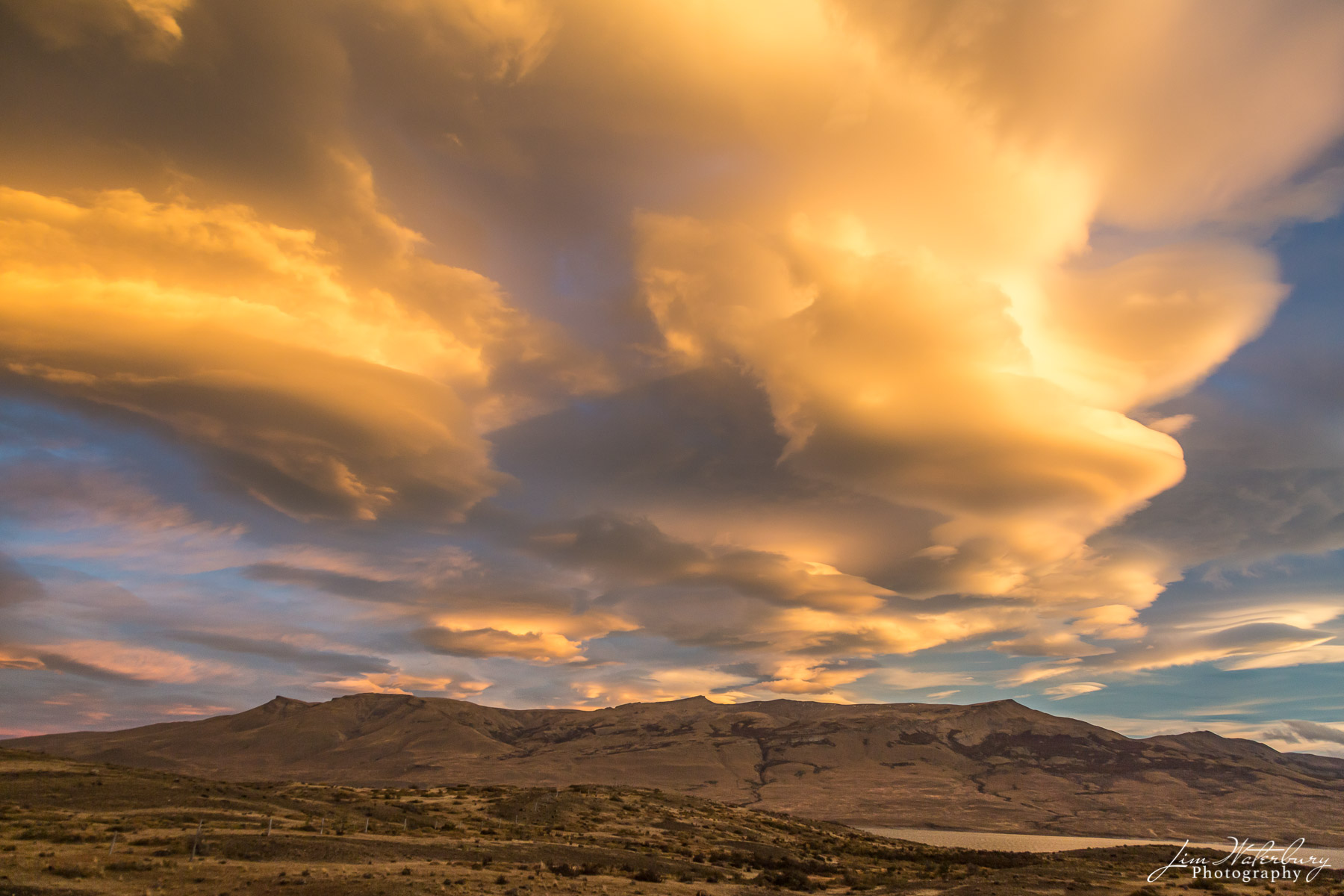 A series of lenticular clouds glow in the late afternoon sun in Torres del Paine National Park, Patagonia.