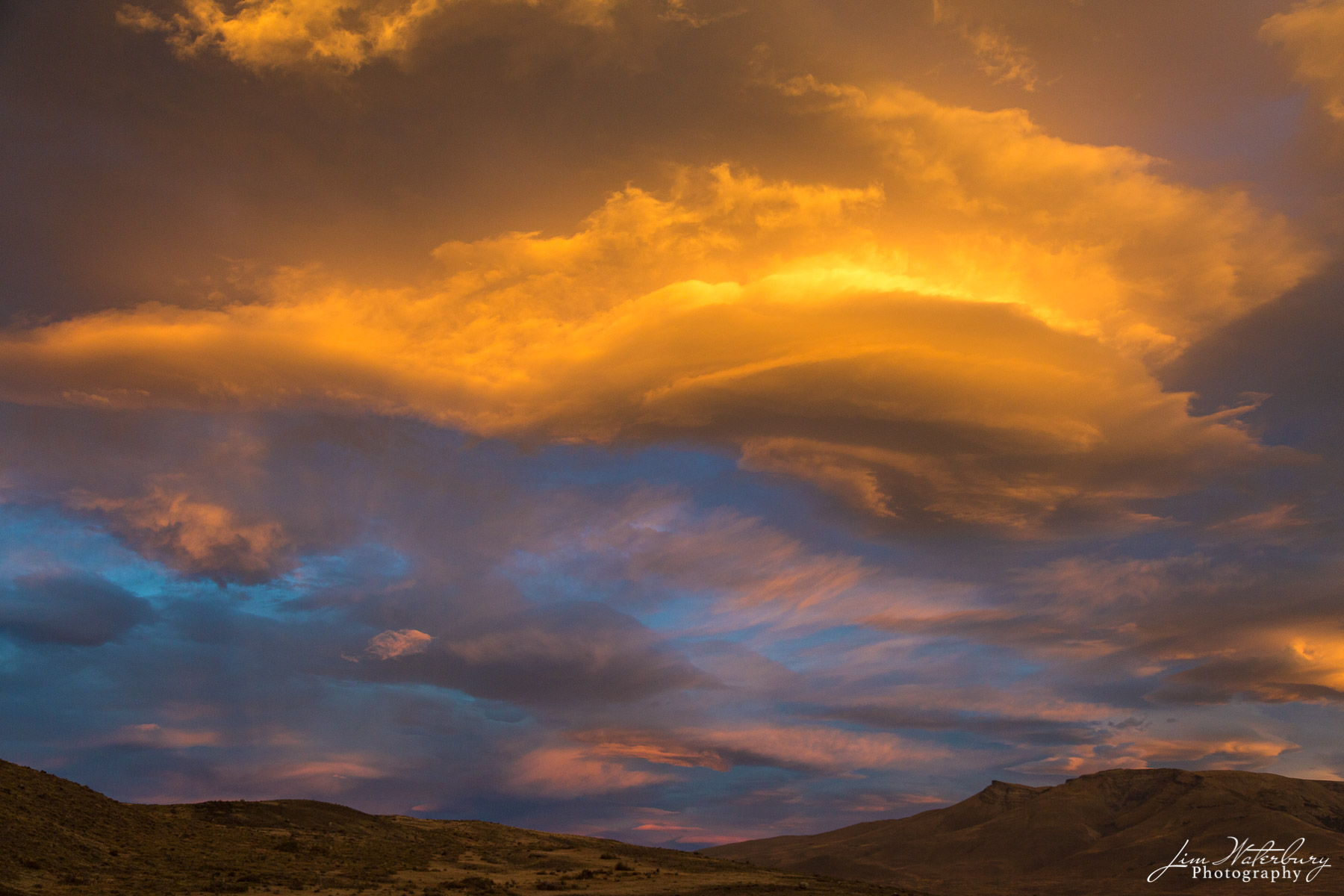 Layers of lenticular clouds at sunset, Torres del Paine National Park, Patagonia.