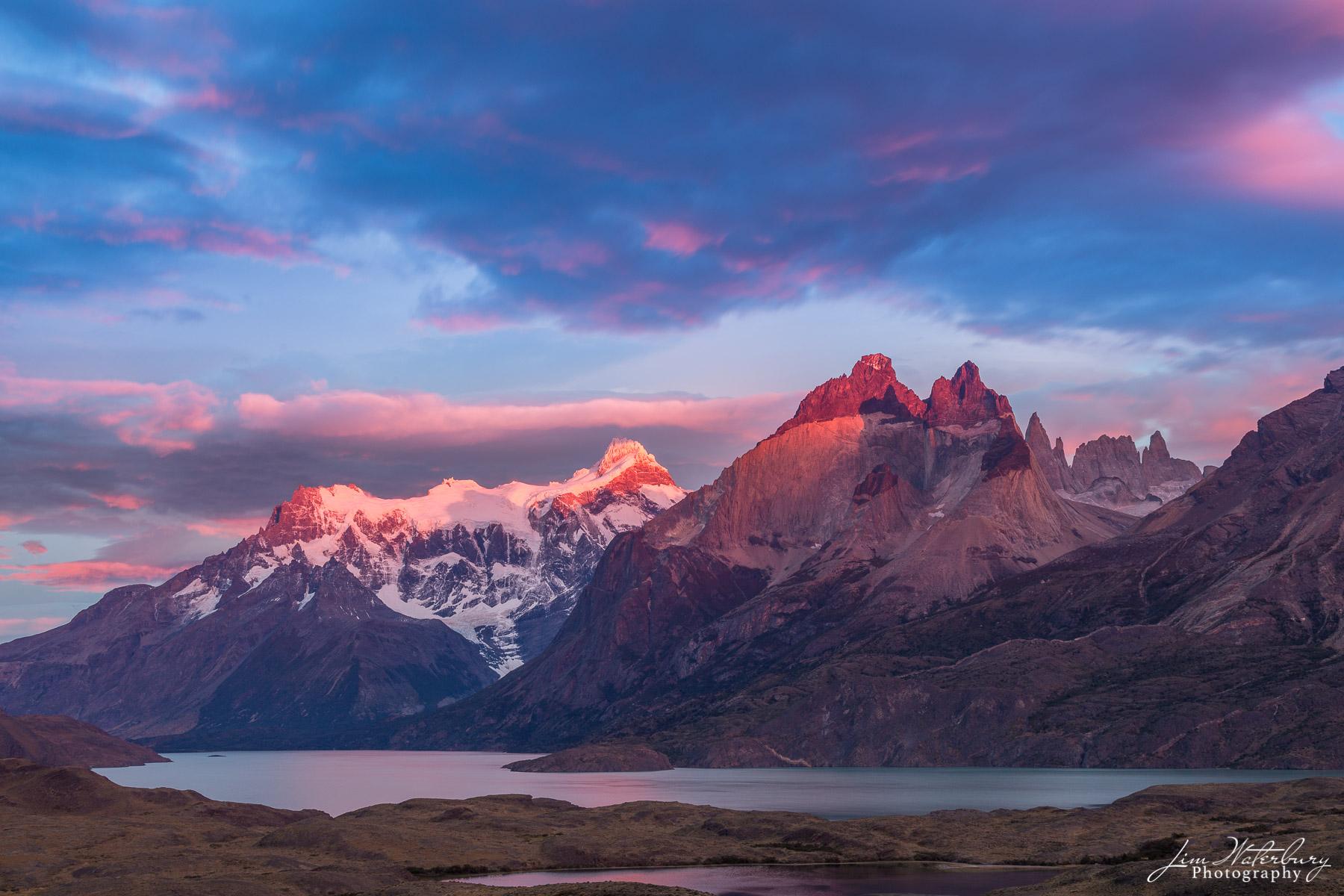 Sunrise over Cerro Torre Massif, Patagonia, reflected in Lago Torre, Los Glaciares National Park, Argentina