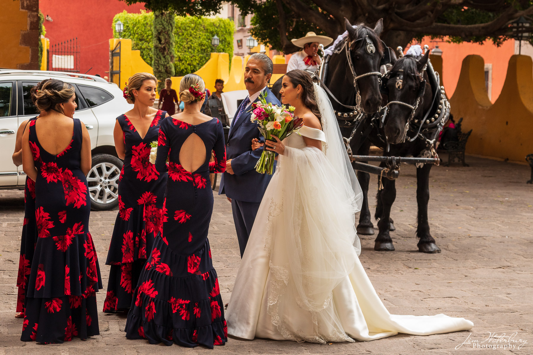 The bride and her father talk with bridesmaids before wedding ceremony in San Miguel de Allende.