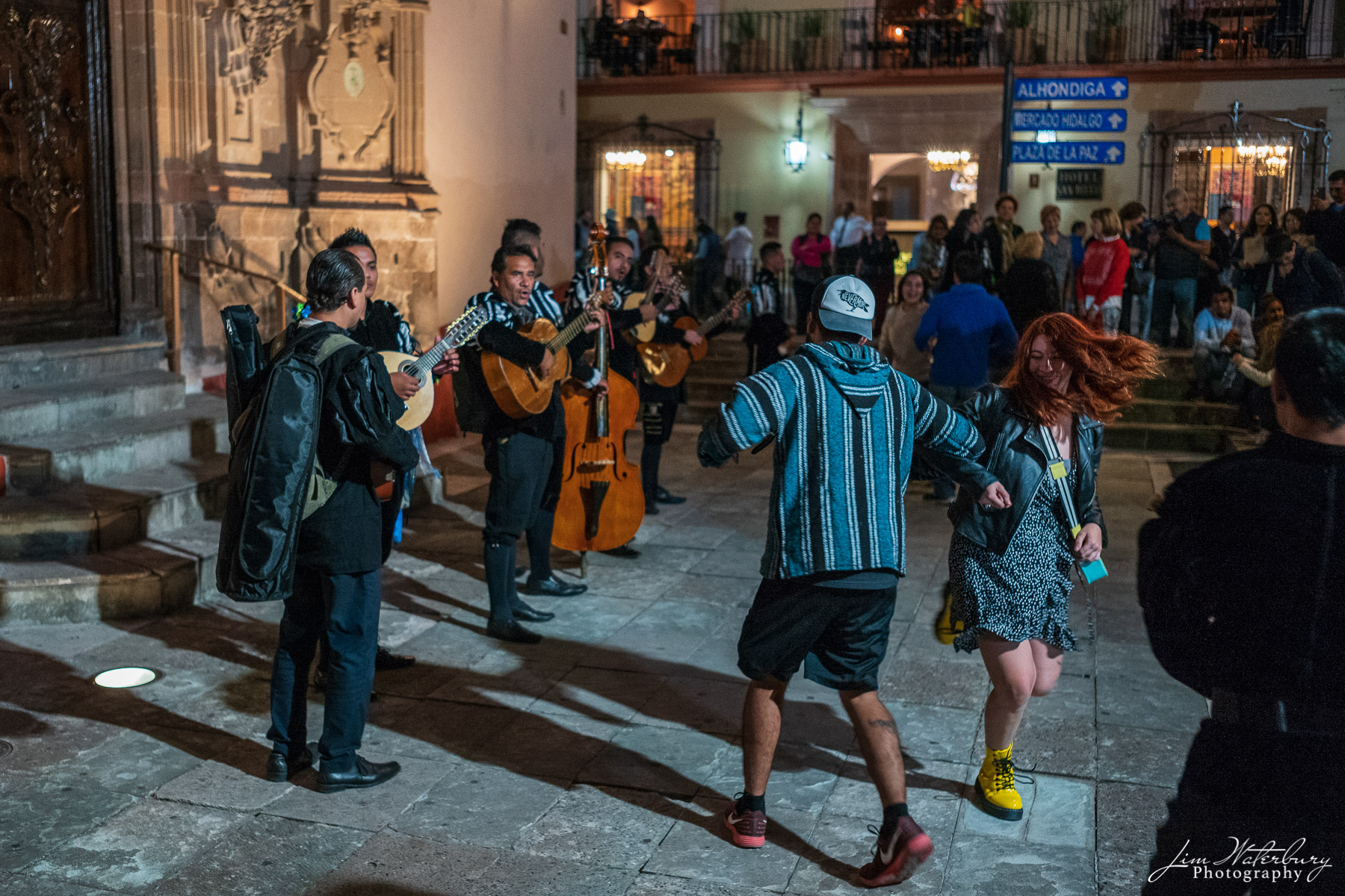 A couple dance in front of the main cathedral in Guanajuato to the music of a local Mexican band.