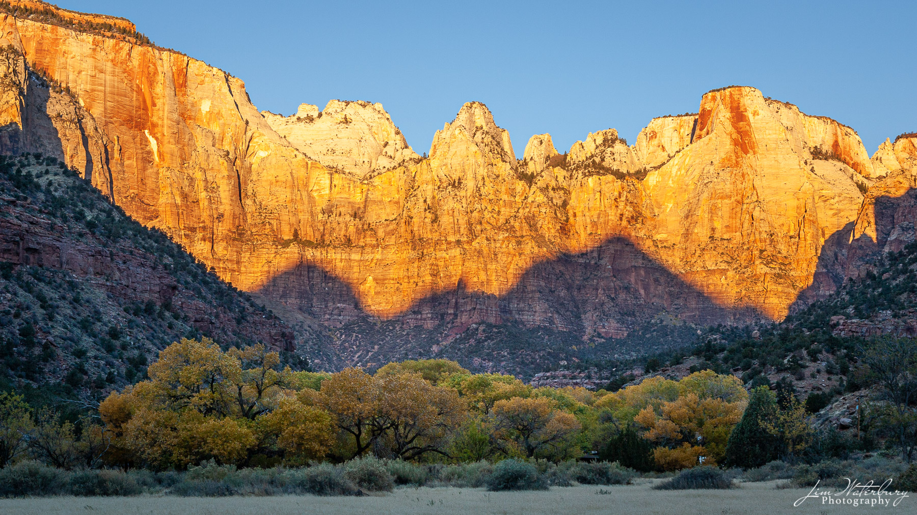 Sunrise on the canyon wall in Zion National Park, Utah.