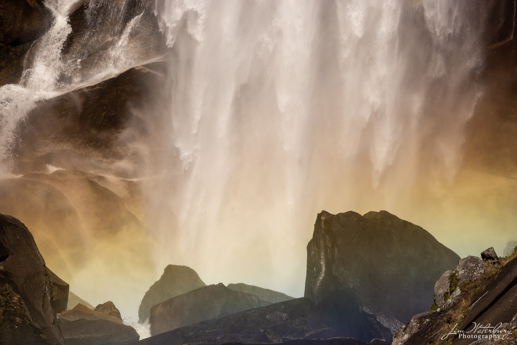 Detail of Vernal Falls, Yosemite Valley, photographed from a rock in the middle of the river, and showing a rainbow of colors...