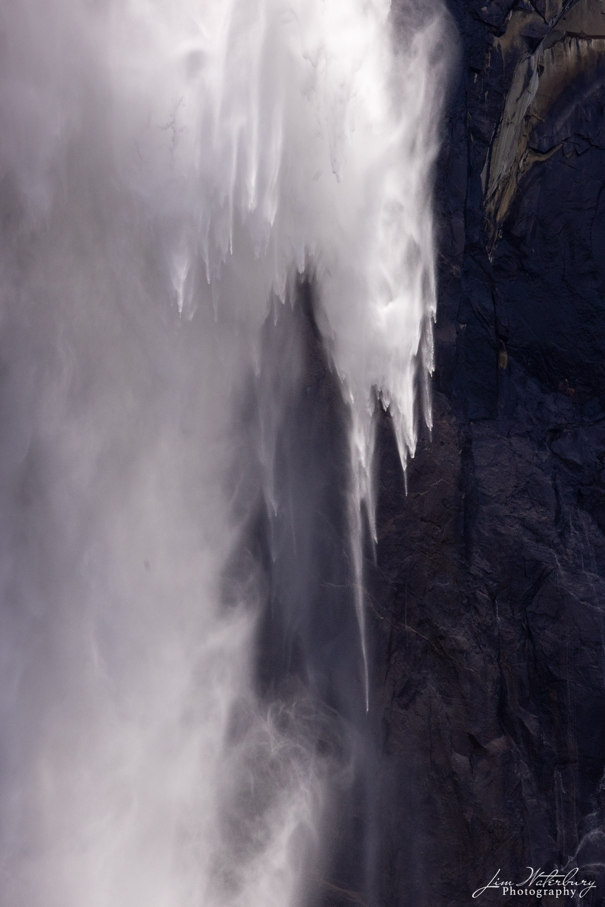 Detail of water and spray descending from Bridel Veil Falls, photographed from across the Merced River